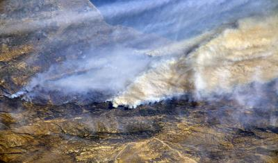 From a Dec. 8, 2017, International Space Station flyover of Southern California, NASA astronaut Randy Bresnik photographed the plumes of smoke rising from wildfires