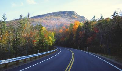 Autumn road to mountains by UNH