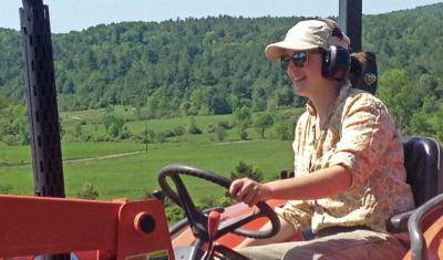Vermont vegetable farmer on tractor